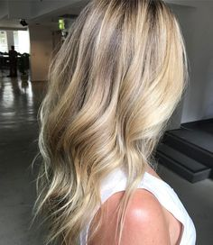 blonde wavy hair long layers  medium length hairstyle ideas