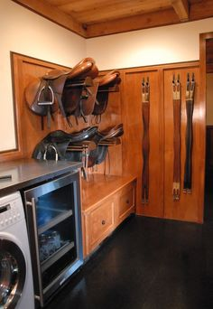 This is a great idea for a mud room/attached tack room! Only substitute draft horse harness and a giant free off craigslist white fridge, but you get the idea.