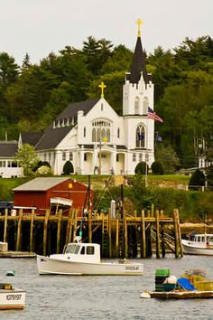 Catholic Church & Boothbay Harbor, Maine.  Boothbay Harbor is a small town on the coast of Maine with a year-round population of just over 2,000 people that was established as a fishing camp and whose economy and spirit are linked to the fishing industry to this day.