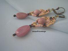 Orecchini in tessitura ,rocaille rosa mat,perle di Rodonite,fatti a mano.