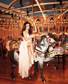 Mila Kunis: I love this bc she's gorgeous and I have always loved carousels! Ohh maybe an idea for someones bridal portrait.