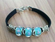 Pandora Style Bracelet by Hecmi on Etsy, $9.00. Put on large leather braided band.