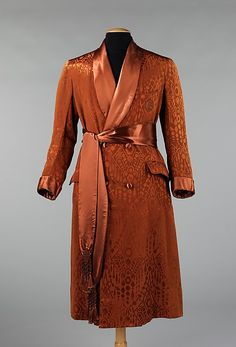 Dressing gown, ca. 1925, The highlight of this dressing gown is its quintessential geometric Art Deco patterning, so popular at the time. Overall, it has a very luxurious and expensive look and feel. This robe would have been worn at home in place of a man's jacket when informally receiving friends.