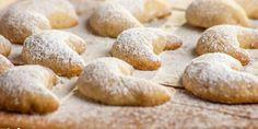 Christmas cookies with vanilla on floured table