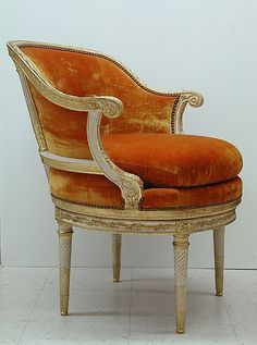 Similar Color to the antique chair I just got.  Mine is a little more dark gold.