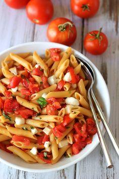 Pasta with fresh tomato sauce and mozzarella. An easy summer pasta using fresh tomatoes and mozzarella
