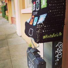 Yarn bombed pay phone. Downtown San Mateo, CA.