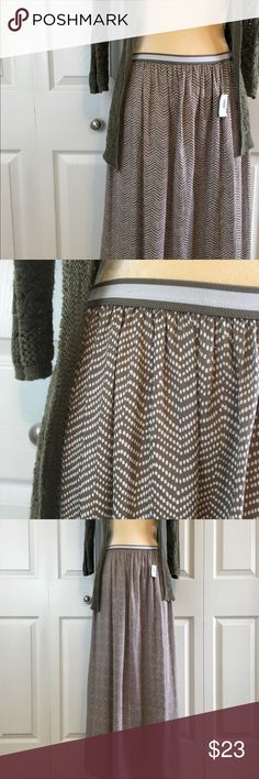 NWT Spotted Maxi Skirt NWT. Beige(ish) color with white spots. In photos it looks a bit like a chevron pattern, but doesn't come off so heavily this pattern in person. Has a silky texture, is light, and comfortable. The waistband is elastic of good quality and makes this skirt a favorite piece for the summer! Old Navy Skirts Maxi