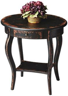 """Butler Oval Accent Table, Midnight Rose Finish by Butler. $329.00. Oval side table. Midnight rose finish. Dimensions: 24""""W x 18""""D x 26""""H. Some assembly required. Weight: 35 lbs. The dark hand-brushed, distressed finish over cherry veneers creates the """"midnight"""" color with rose colored undertones. Includes a single drawer with a matching antique brass finished knob. The lower shelf is an excellent display area."""