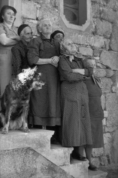 Henri Cartier Bresson - truly delightful shot - and the dog - as if placed by a skilled cinematographer. Dogs are the ever present symbol of instinct for movie makers. Here the canine stares past the disapproving clutch of grannies in the shadows - sunshine on the back of his head - seeing something altogether different to the object of human judgement.