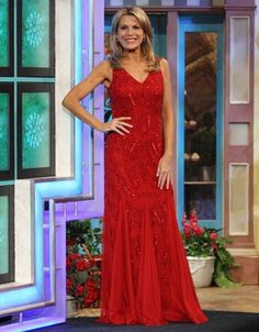 CACHE: Red gown w/sequins & beads in abstract geometric patterns, v-neckline, sleeveless, keyhole cutout back, skirt w/gores of red net | Vanna White's dresses | Wheel of Fortune