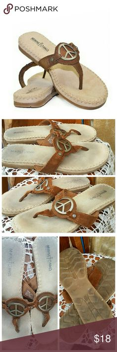"""Minnetonka suede Peace thong sandals used Put a little spring into your step with this must-have thong sandal. Smooth suede uppers feature peace sign embellishments for style. Beautiful whipstitch detailing offers added interest and appeal. - Lightly padded footbed  - Flexible rubber outsole  - Fits true to size   All shoes in my closet sold """"as is"""" no returns. See photos for condition. Minnetonka Shoes Sandals"""