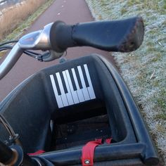 Decorative Duct Tape Piano Keyboard on the black surface of a cargo bike.