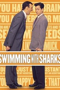 Originally screened at Telluride as The Buddy Factor, Swimming With Sharks is an uneven but engrossing picture, and a possible warning to anyone with plans to break into the motion-picture business. When Guy (Frank Whaley), a recent film-school graduate with big ideas, takes a job as assistant to major studio executive Buddy Ackerman (Kevin Spacey), he believes his ship has finally come in; little does he know it's a slave ship, for his boss is indeed worse than a slave driver. Buddy…