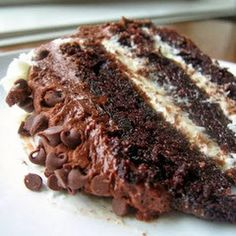 Chocolate layer cake with cream cheese filling and chocolate buttercream--can you imagine? Cream cheese filling AND chocolate buttercream? I can't take my eyes off of this slice of decadence!!
