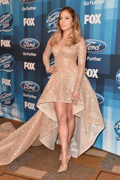 Jennifer Lopez Evening Pumps - Jennifer Lopez kept the glitter coming with a pair of gold Christian Louboutin Toerless Muse pumps.