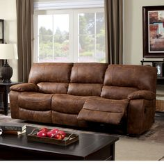 The wide seats of this stylish sofa draws attention to the rustic brown, bonded leather upholstery. Each end seat reclines easily for added comfort and usage. Set includes: One (1) sofa Materials: Woo