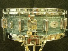 From Steve Maxwell Drums, a vintage Rogers Dynasonic snare, one of the rarest of all wood dynas. This drum is 5x14 and is in ultra rare blue strata. Blue strata was only in the Rogers color line for one year in 1967. This drum has excellent color, very nice chrome, and would make a superb addition to a fine collection. The sound is classic, fabulous Rogers: wonderful sensitivity and projection, and superb response throughout the dynamic range.