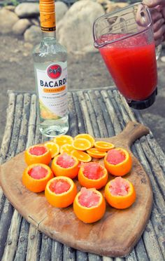 "Mix up a few shots of Bacardí with your favorite fruit juice. I used strawberry lemonade. Add ice to fill the blender, and pour the mixture into orange ""shot glasses."" These taste amazing!"