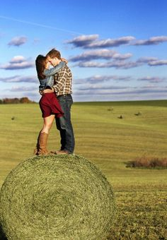 Country engagement photo.  Hay bale.