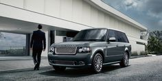 i swear there is nothing more chic looking then a man in a black suit getting out of a range rover.