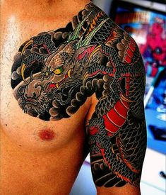 Guy With Shiny Red And Black Japanese Sleeve Tattoo