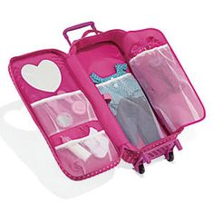 """18 Inch Doll Travel Case: Our charming doll case is fun to wheel along, and will keep her 18"""" doll protected during travel and at home. She can fasten her doll in securely, thanks to easy, hook 'n loop straps. Five roomy pockets store doll clothes and accessories. The case detaches from the wheeled cart for hand carrying. 9""""L x 6""""W x 20""""H, with telescoping handle (extends from 22 1/4""""-30""""L). Also fits 18"""" Madame Alexander® and Our Generation® dolls. Personalize it!"""