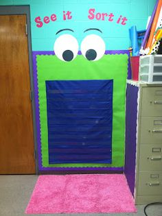 Cute idea! Life in First Grade: Classroom Decorating Day 7: See it Sort it Pocket Chart Center