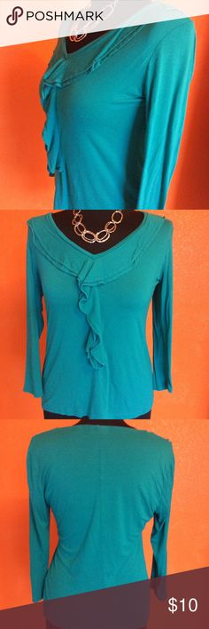 Cute NY&Co teal blouse with ruffle Cute NY&Co teal blouse with ruffle, excellent condition, worn twice. Like much of my new wardrobe became small because of change in job/activity/weight. New York & Company Tops Blouses