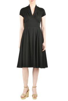 Soft cotton knit falls gracefully into the pleated bodice and flowing skirt of our feminine fit-and-flare dress accented with a wide banded empire waist.