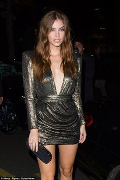 Model behaviour: Barbara Palvin proved just what turned their heads as she stepped out during Paris Fashion Week on Tuesday