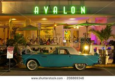 MIAMI, USA - JUNE 7, 2012: The Art Deco Avalon Hotel and a classic car at night on Ocean Drive. South Beach, Miami, Florida, United States of America, june 7 2012