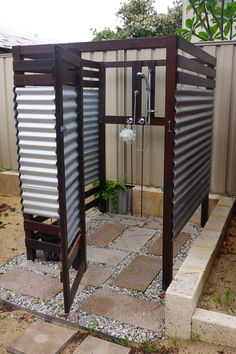 Outdoor shower. Jarrah & corrugated iron.
