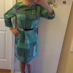 """The limited BNWT classic shift dress Petites Belt included but can be switched out. I'm usually not a fan of green, but this is such a Audt feminine green that just pops with the black & white. Bust: 17.5"""". Bottom of dress 19"""" wide. Back is rounded and 2"""" longer. Shoulders: 3"""" sleeves: 17"""" end of sleeve width: 4.5"""". Buttons in back at top of dress. Top of shoulder to bottom: 36"""". Made of polyester. A lightweight smooth material. Perfect fit any season. Plus free thank you gift for all my…"""
