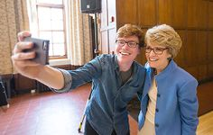 "A Wolverine captures a ""selfie"" with President Mary Sue Coleman during a celebration thanking her for her 12 years of leading #UMich."