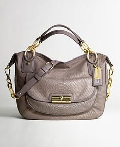 Coach.  Can't live without them!  I have this one in black.  Love it!