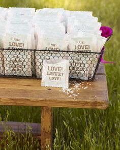 For an outdoor wedding... instead of a formal exit from the reception... guests shower you as you walk down the aisle together. Vellum bags of Ecofetti displayed in a wire basket for guests to take