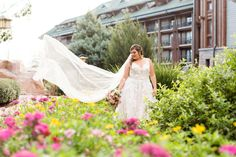 Disney bridal portraits with veil flying in the wind at Disney's Wilderness Lodge Resort