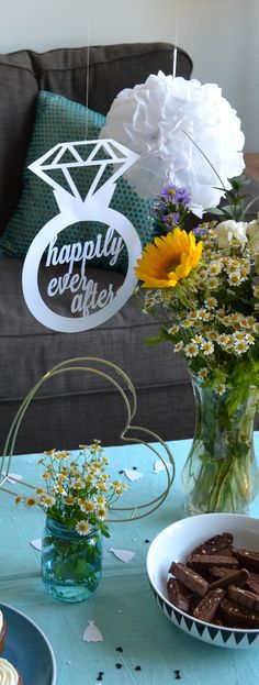 "Bridal shower decor idea - hanging ""happily ever after"" signs and tissue paper poms"