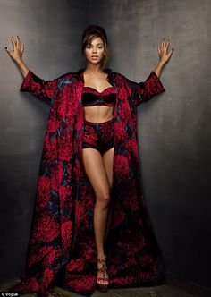 In the boudoir with Beyonce: Queen B displays her famous figure in a stunning black and red Fifties-style floral bra, panties and dramatic kimono as she strips down to her lingerie for the March issue of Vogue
