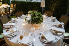 Table settings included traditional garden-style folding chairs and crisp, white linens, along with floating candles and greenery centerpieces. The menu included lobster salad, heirloom tomatoes and burrata, and herbed lamb with mustard sauce from Glorious Food.  Photo: Carolyn Curtis for BizBash