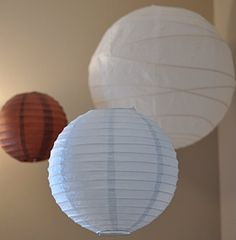 Deluxe 10 Inch Round White Paper Lantern / Light Shade null http://www.amazon.co.uk/dp/B00V959VQ4/ref=cm_sw_r_pi_dp_HYUgwb0WDZ3JC