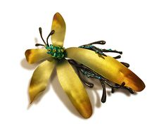 JOSE MARIN DAWN INSIDE THE JUNGLE  Brooch. Titanium, sterling silver, steel, lacquer