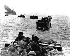 D-Day, Juno Beach - On board their assault landing crafts, men of the Royal Winnipeg Rifles heading towards their sector of Juno Beach, June 6, 1944.