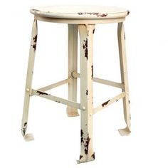 White metal stool with weathered details.  Product: StoolConstruction Material: MetalColor: Antique whiteFeatures: Weathered finishDimensions: 19 H x 12 Diameter