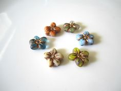SAVE 10% use coupon code PIN10 These beautiful mixture of flowers consist of one aqua orange, green, blue and ivory Czech glass flower beads great for any piece of jewelry or project.  Quantity: 6   Size...