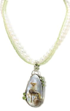 Caracol - Inspired Jewelry and Handbags - Echo of the Dreamer Carved Mother of Pearl Horse | Peridot Necklace, $274.00 (http://www.caracolsilver.com/echo-of-the-dreamer-carved-mother-of-pearl-horse-peridot-necklace/)