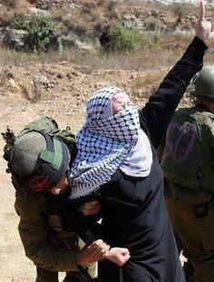 IOF arrest a Palestinian women at a peaceful protest