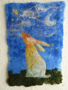 """Hand felted Wallhanging:  I love the mystical imagery of the """"Moongazing"""" Hare.   I've been experimenting with wet-felting for a while, but I've only just got to the point where I'm confident enough to put my work up for sale. This was my first big sale, and I'm still very proud of him.  I've tried one or two smaller hares since, and I think it's a subject I'll come back to again, albeit a different style."""