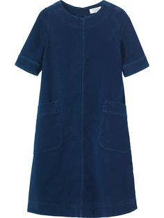 A-line dress with two deep patch pockets in a soft and supple, washed, real indigo-dyed moleskin. Lightly fitted at top and across shoulders, flaring into a full, A-line shape through the body. Metal zip at back with grosgrain puller. Deep hem detailing.